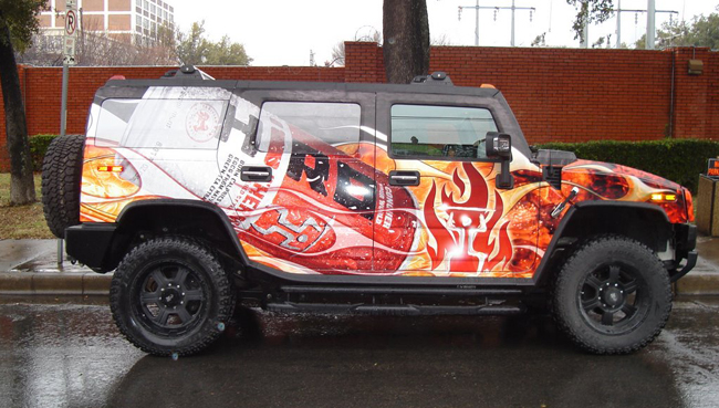 Custom flat black wrap with high gloss overlays on an H2 for Hiro Tahitian Noni energy drink