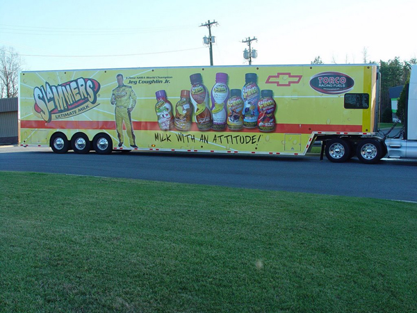 Vinyl graphics wraps on a race hauler for Slammers