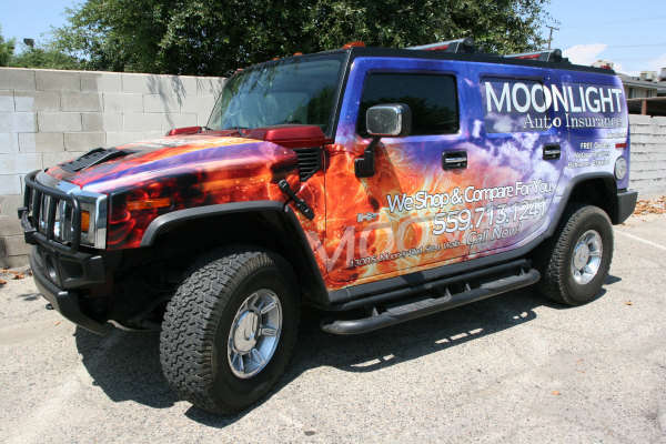 Vinyl graphics wrap installed on a Hummer H2 for Moonlight Auto Insurance in L.A