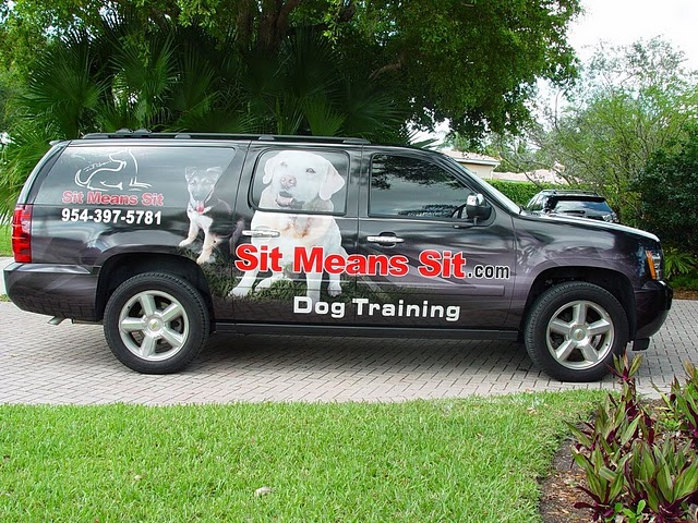 Vehicle graphics wraps installed on a Chevy Suburban for Sit Means Sit in Ft-Lauderdale