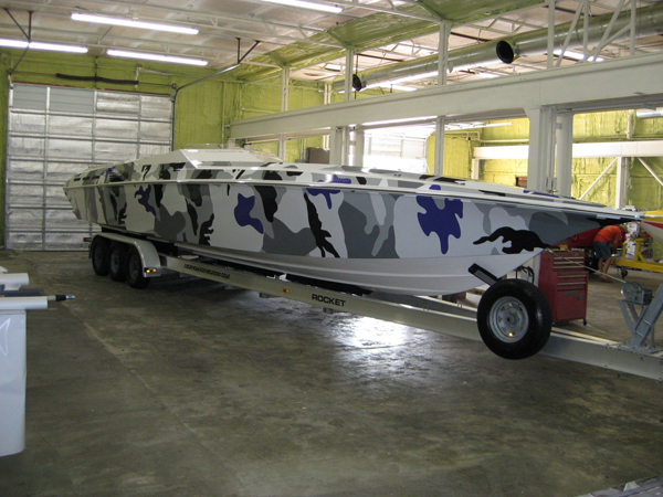 Full vinyl graphics wraps of 42' Fountain boat in Dallas TX