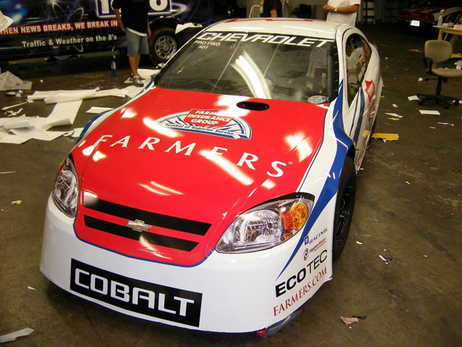 Car wraps on Chevy Cobalt race car for Farmers Insurance