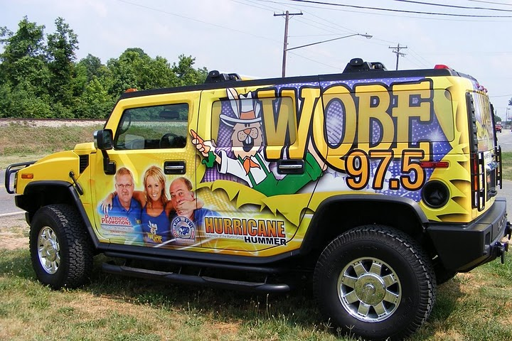 Custom vinyl wraps installed on a Hummer H2 for Bristol Broadcasting radio station WQBE 97.5