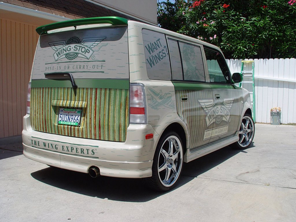 Car wraps installed on a Scion XB for Wingstop