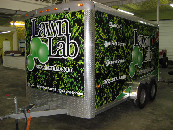 Vinyl graphics wraps on trailer for Lawn Lab in Dallas