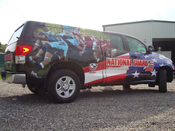 Custom vinyl wraps installed on a Truck for the National Guard Rugby Team