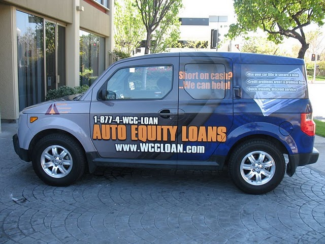 Vehicle wraps installed on a Honda Element for Wilshire Community Credit