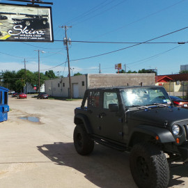 Profile View Matte Black Car Wrap Jeep Wrangler
