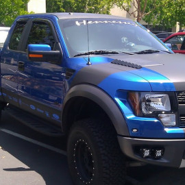 Matte black and metallic blue Ford truck