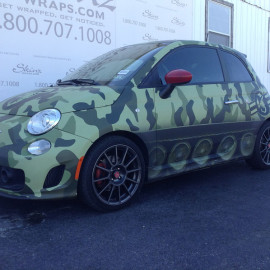 Vehicle wrapping that looks like a tank