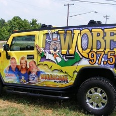 vinyl-wraps-installed-on-a-Hummer-H2-for-Bristol-Broadcasting-radio-station-WQBE-97.5